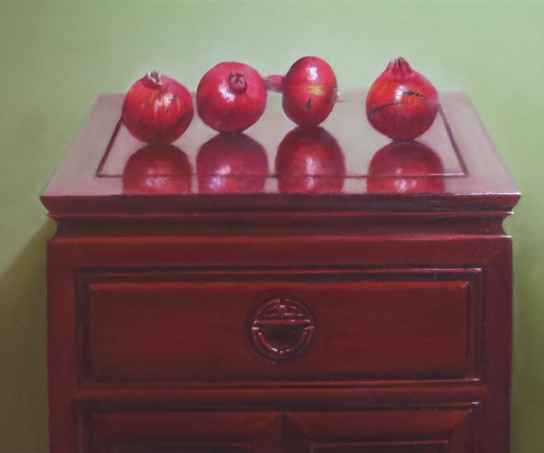 Pomegranates on rosewood