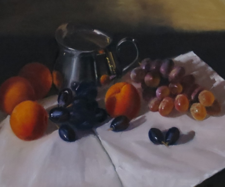 Silver jug with fruit
